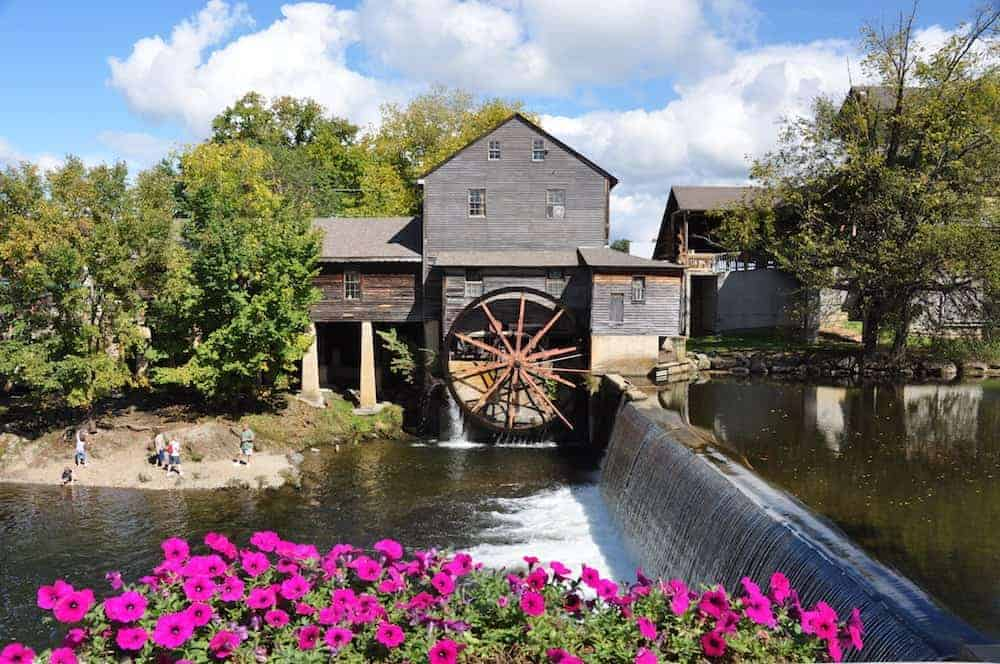 The Old Mill in Pigeon Forge with springtime flowers