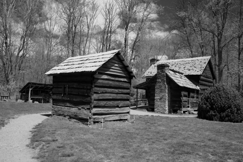 Black and white images of wood cabins in the Smoky Mountains