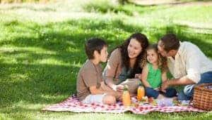 Family having a picnic outside