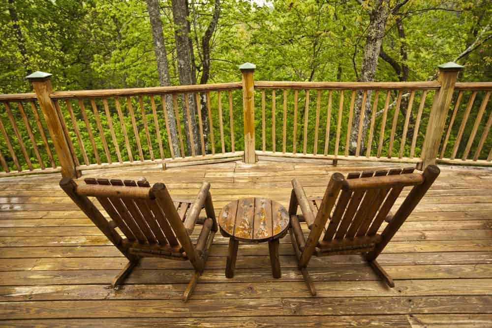 Two wooden chairs on the deck of a Pigeon Forge or Gatlinburg cabin in the Smoky Mountains