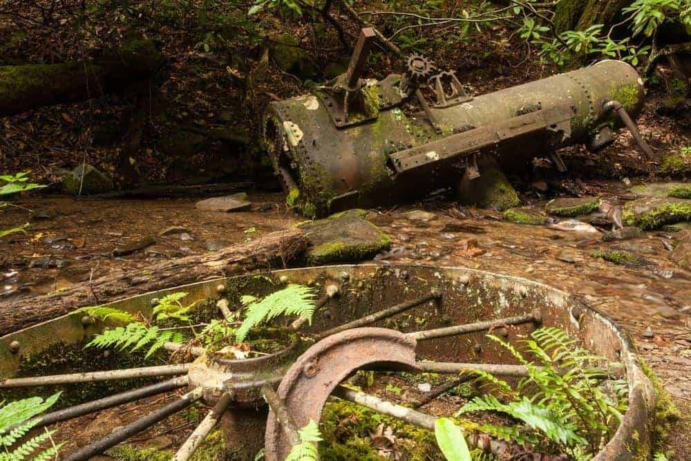 Old wagon parts near one of the abandoned places to visit in Great Smoky Mountains National Park