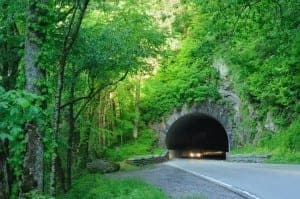 Car driving through a tunnel near the Great Smoky Mountains National Park visitor center.