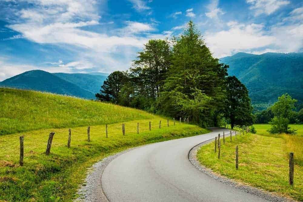 Scenic road in Cades Cove that visitors can enjoy on a Smoky Mountain vacation.