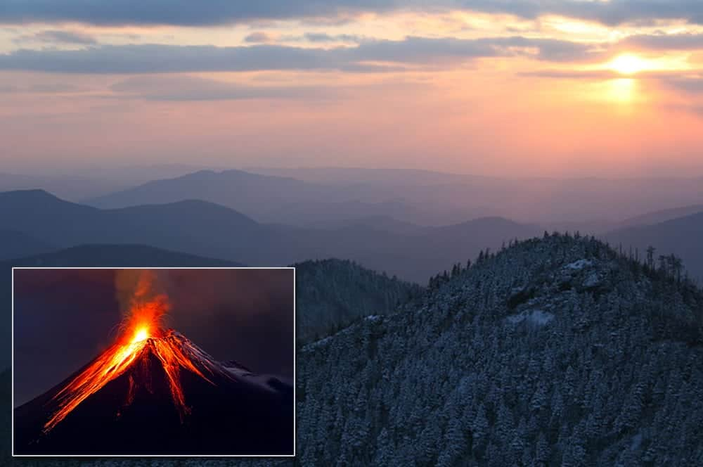 Photo of an erupting volcano embedded in a scenic photo of the Great Smoky Mountains.
