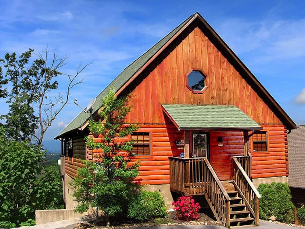 Destiny Den... A rustic luxury cabin that has a beautiful mountain sunset view!