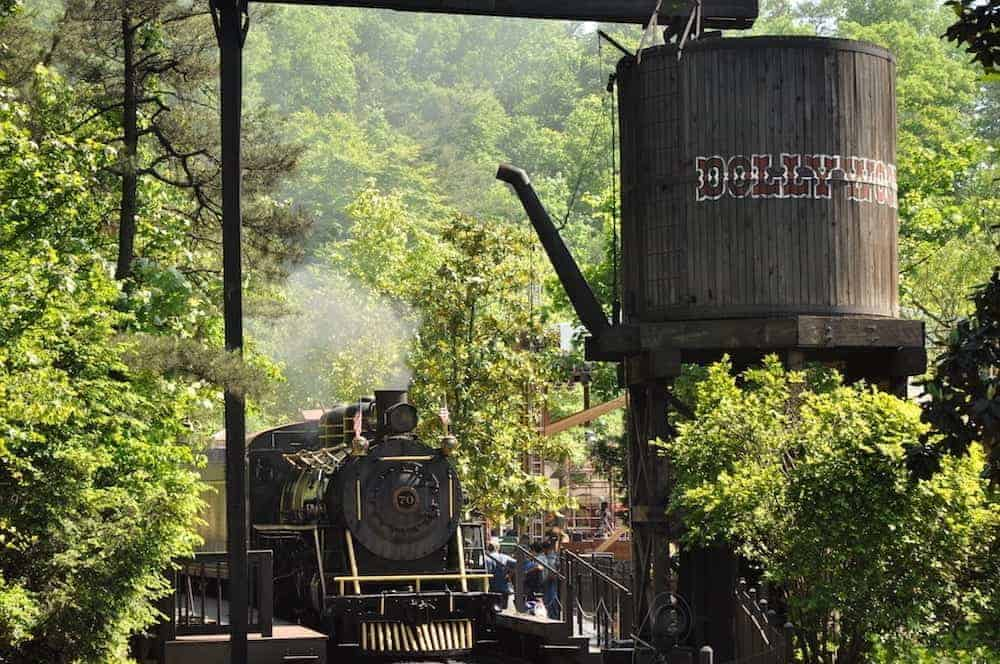 A train pulling into the station at the Dollywood theme park.