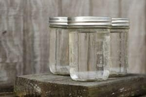 Mason jars filled with moonshine.