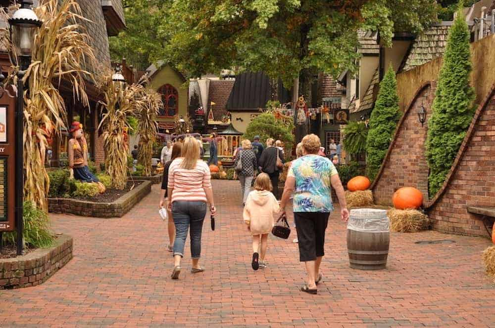 A family walking through The Village in downtown Gatlinburg.