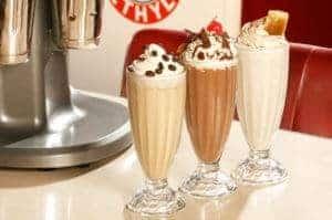 Delicious milkshakes on a table.