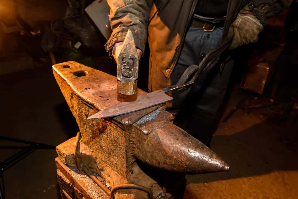 A knife being made in a blacksmith shop.