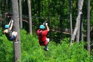 people ziplining at anakeesta