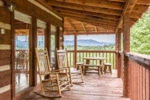 two chairs on the deck of a Gatlinburg cabin