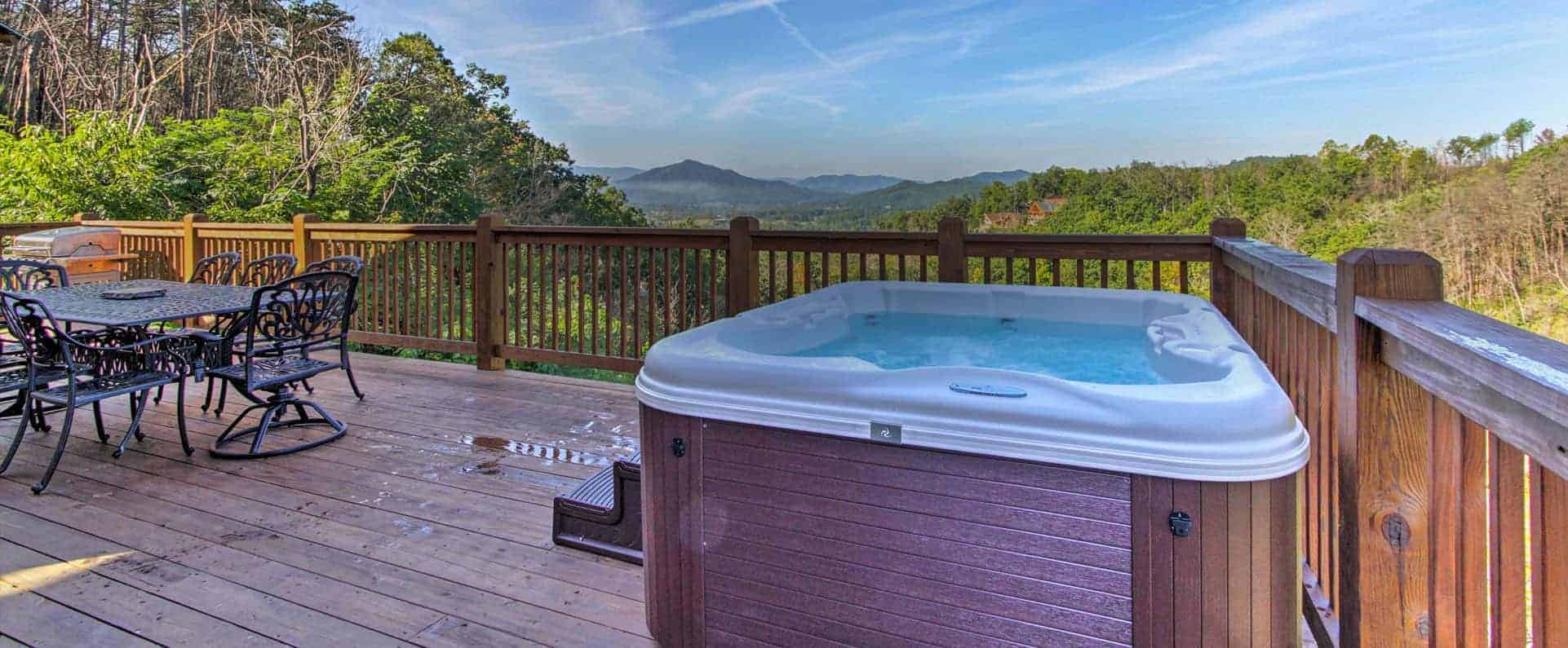hot tub and patio furniture at a cabin