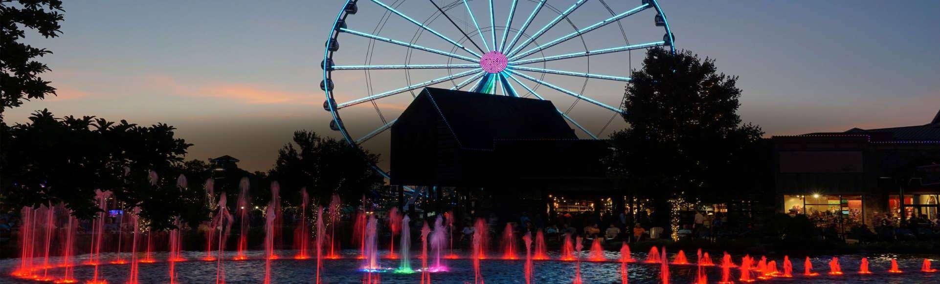the island show fountain at dusk
