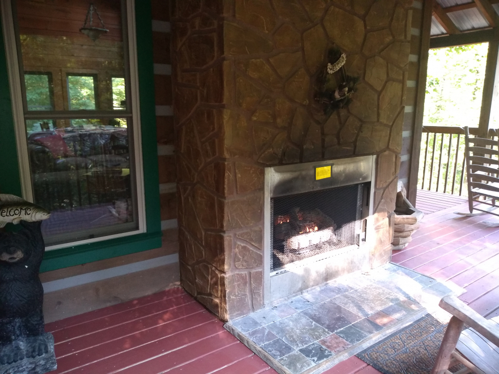 Outside fireplace on covered deck